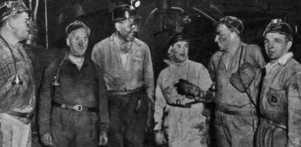 To see their company's products in use, Dowty group executives go down Calverton colliery. Left to right: Dowty Mining Equipment Co. mining manager M. Potts; Calverton agent-manager W.T. Elliott; public relations adviser C.G. Irving; Miss B. Wallis, secretary to Sir George Dowty; joint publicity manager G.R. Edwards; service manager A. Hodkinson.